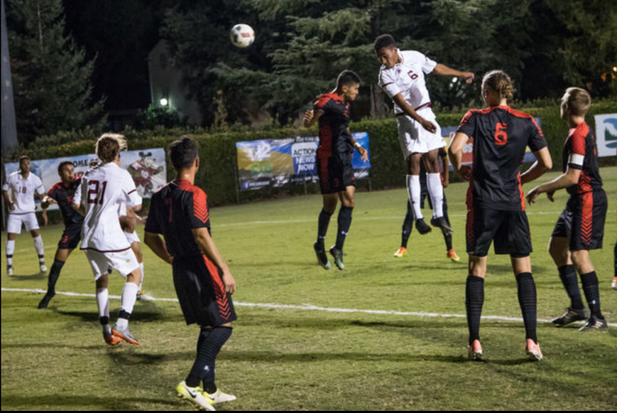 Senior defender Donta'e Garcia heads the ball away from the opposition. Photo credit: Ryan Mccasland