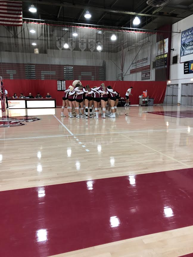 Chico State huddles before the start of the first set on Saturday in a game against Cal State East Bay. Photo credit: Lucero Del Rayo-Nava