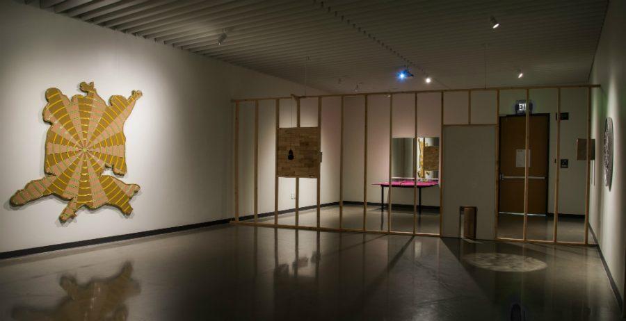Trong Gia Nguyen set up a variety of art pieces at the Jacki Headley Art Gallery earlier last week. Photo credit: Tara Killoran