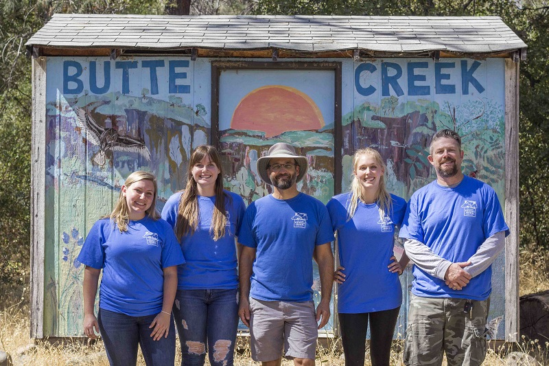 Left to Right: Ashley Manley, Kate Liggett, Jon Aull, Sierra Baker, Carter Moore. Staff poses for a picture at the Butte Creek Ecological Preserve on Friday, after their intern training session. Photo credit: Brian Luong