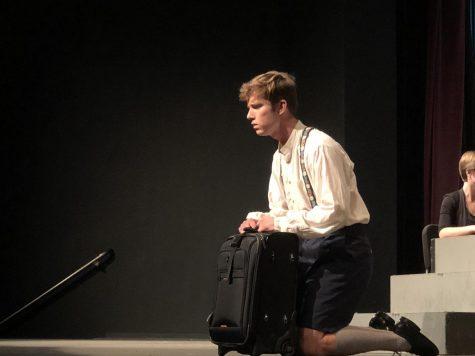 Candide (Valdis Birznick) singing during a musical number. Photo credit: Alex Coba