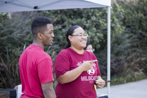 Krystle Tonga (right) jokes with Amanual Gebre (left) while setting up for Wildcat Vibe Thursday. This event is held every year as well and gives club organizers the opportunity to register their club. It's not too late to find a group as Clubtacular will give students another opportunity to join or create a club. Photo credit: Brian Luong