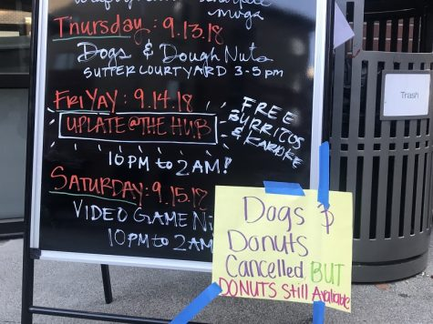 HUB Happening board with a Dog and Donuts canceled sign that broke students hearts Photo credit: Justin Jackson