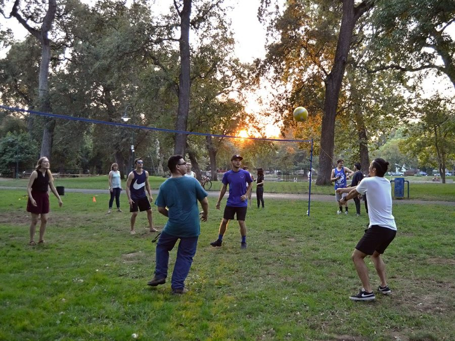 Students part of Christian Challenge hang out at One Mile over the weekend to barbecue and play a game of volleyball. Photo credit: Olyvia Simpson