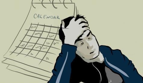 Man stressed on an overloaded schedule. Photo credit: Diego Ramirez