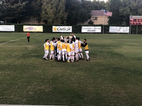 Chico State men's soccer huddles up before their playoff game against UC San Diego on Tuesday. Photo credit: Connor Mcpherson