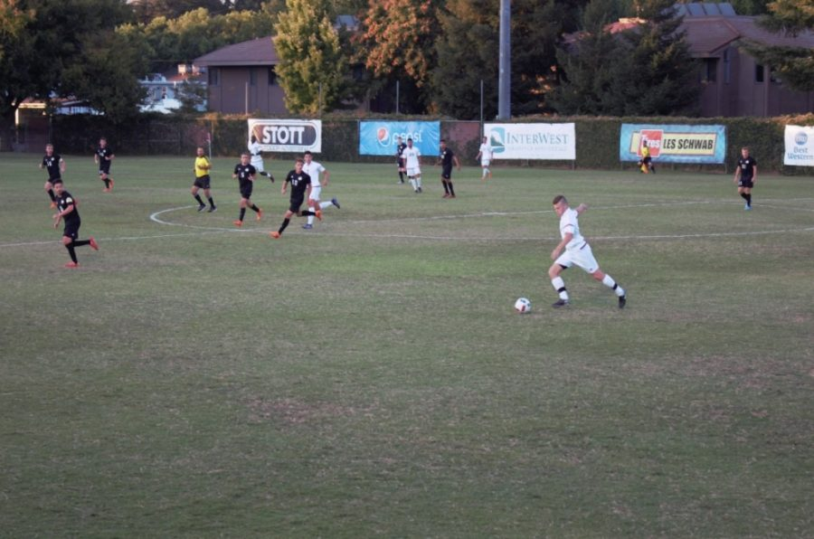 A Chico State defender strikes a free kick in a game against Seattle Pacific University in this archived photo Photo credit: Maury Montalvo