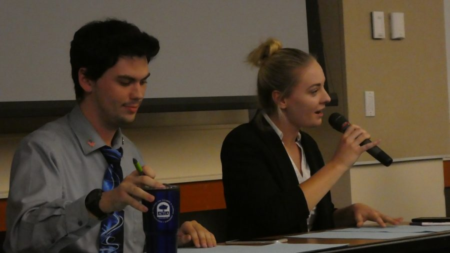 Christian Wilson,(left) and Kelsey McCaffrey (right), debate on the side saying that YouTube has done more harm than good for democracy. Photo credit: Josh Cozine