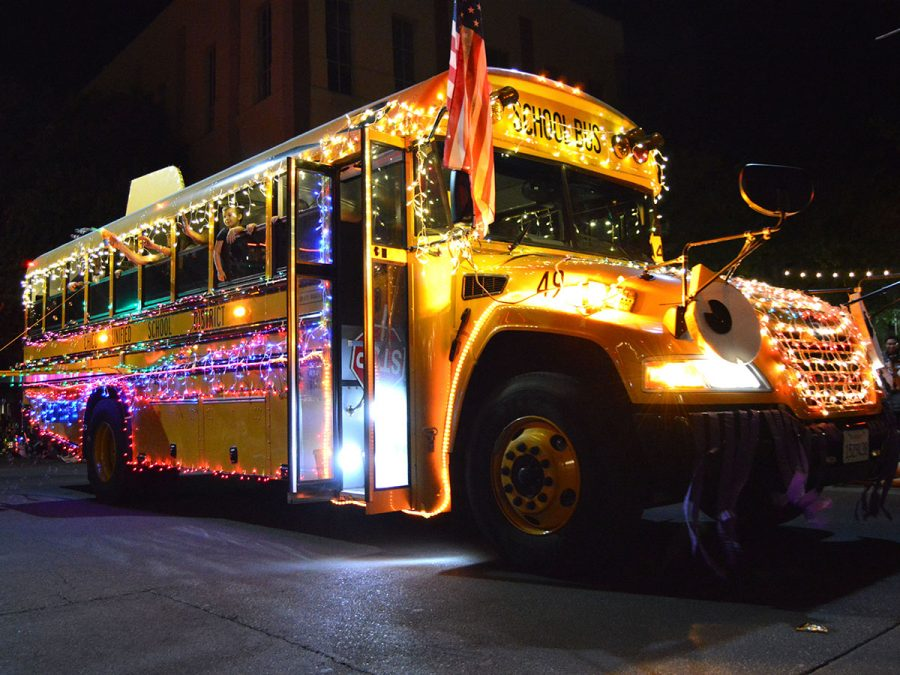 A Chico Unified School District bus proves at the Chico Parade of Lights that creativity does not stop with light decorations as any vehicle or object can be used as well. Photo credit: Olyvia Simpson