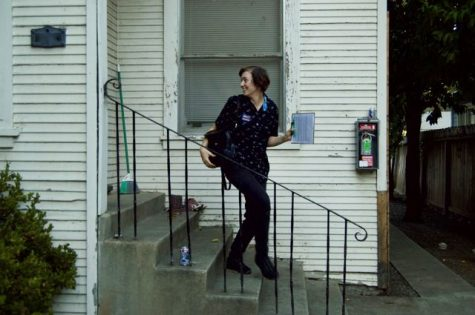 Bryce Goldstein goes door-to-door balloting for local city council candidate Alex Brown. Photo credit: Daelin Wofford