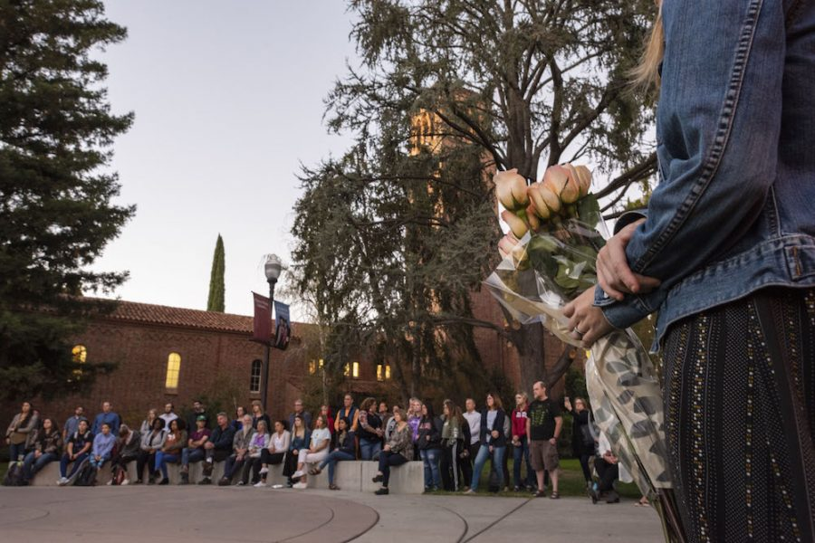 Flowers were available as campus and community members attend the vigil in remembrance of the tragic death of a member of the Butte County community on Monday, November 5, 2018 in Chico, Calif. Students and faculty in an interdisciplinary course focused on homelessness organized the vigil in memory of the life lost on our campus and in recognition of the vulnerability of individuals experiencing homelessness. (Jason Halley/University Photographer/CSU Chico)