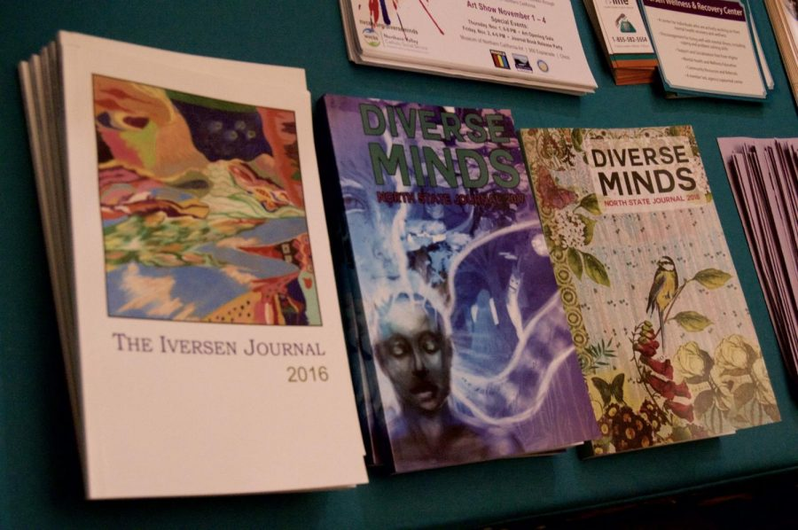 The intimate art show featured journals available for purchase at the front of the building. Photo credit: Daelin Wofford