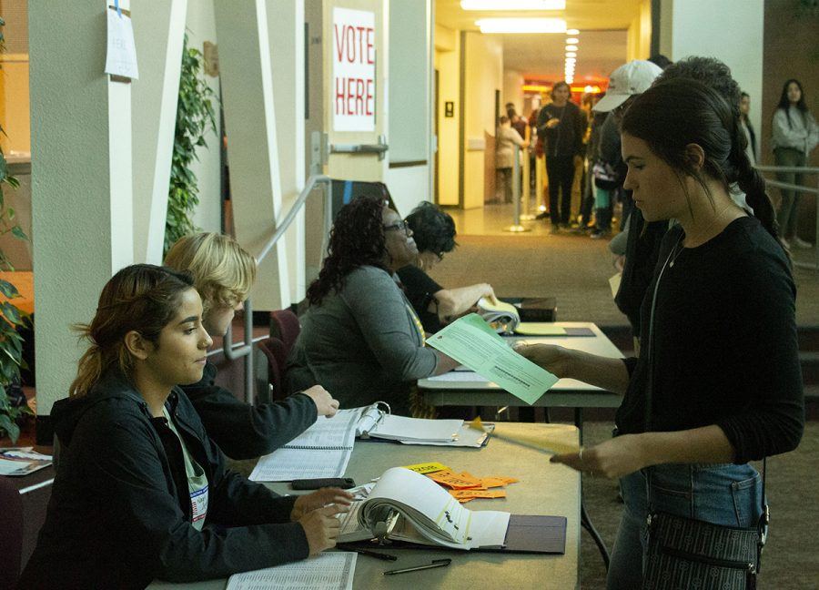 Chico State students check in at the Bell Memorial Union auditorium to vote for the most recent election on Tuesday. Photo credit: Dominique Wood