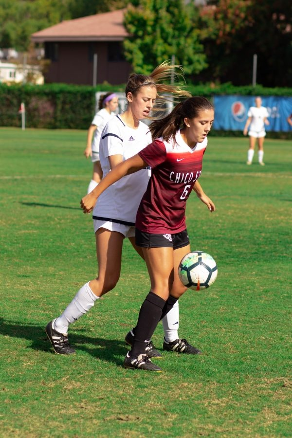 Chico+State+forward+Susanna+Garcia+fights+for+the+ball+against+tough+defense+from+UC+San+Diego+in+this+archived+photo.+Photo+credit%3A+Maury+Montalvo