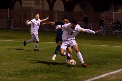 Chico State defender Garrett Hogbin keeps the ball away from UC San Diego in this archived photo. Photo credit: Maury Montalvo