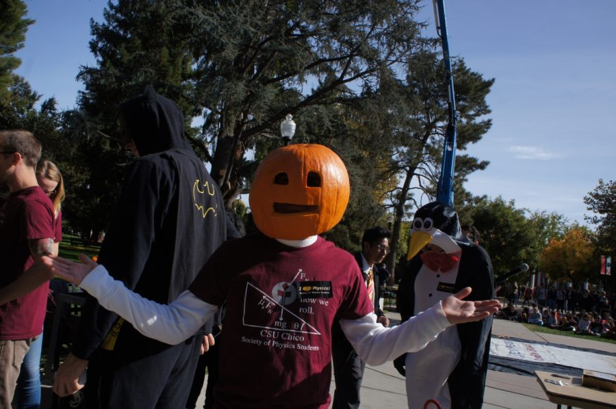 One of the Chico State physics students wearing a pumpkin on his head during the annual pumpkin drop. Photo credit: Keelie Lewis