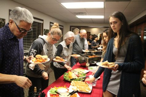 Fans, parents and players getting food before announcements start at the Tip-Off Social on Tuesday. Photo credit: Ricardo Tovar