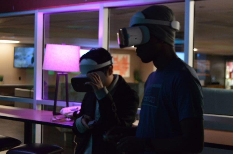 Carlos Pioroda and Kendrick Short experiencing VR gaming Night in the basement of the BMU. Photo credit: Daelin Wofford
