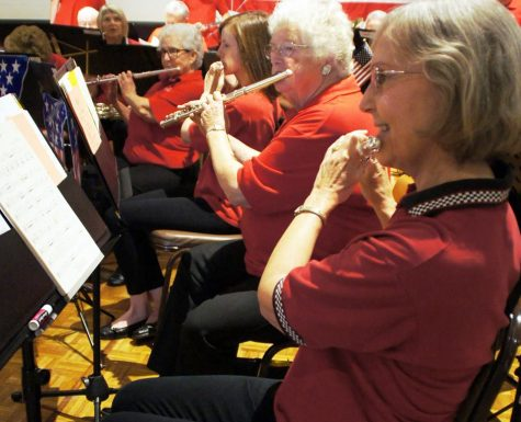 The Chico Community Concert Band flute section plays at the Chico Elks Lodge on Nov. 11, 2016, during a Veterans Day program. From left: Linda Gould, Carolyn Hamilton, Jackie Corrie and Sanda Doerschlag. Image courtesy of Mark Plenke.