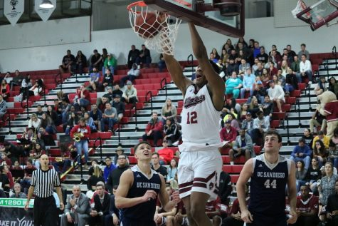 Senior Marvin Timothy dunks the ball against UC San Diego, Thursday night at Acker Gymnasium. Photo credit: Christian Solis