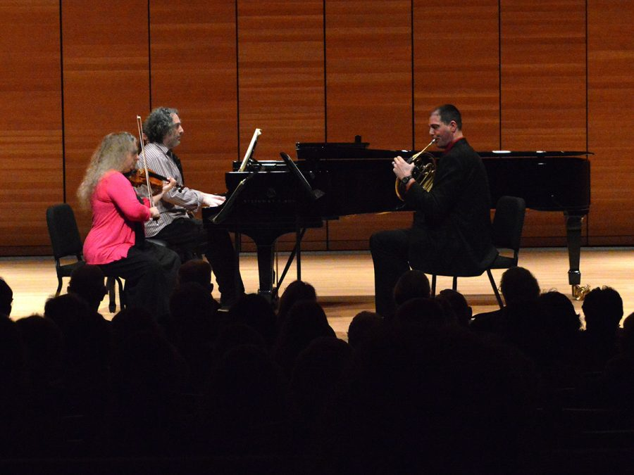 """Terrie Baune, John Chernoff and Dan Nebel perform Horn Trio in E Flat major. """"The horn isn't typically an accompaniment of piano and violin,"""" Nebel said, but the French Horn addition enhanced the composition of the piece. Photo credit: Olyvia Simpson"""