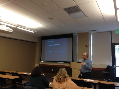 Russ Hanson (right) gives a presentation discussing the process of grief. Photo credit: Julian Mendoza