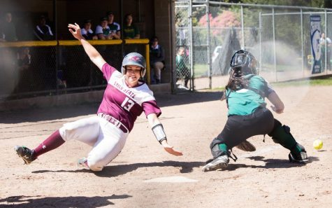 Senior Bailey Akins slides into home. Photo credit: Janna Weiss