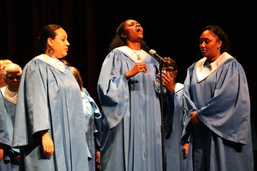 Three ladies take turns singing their parts of the song