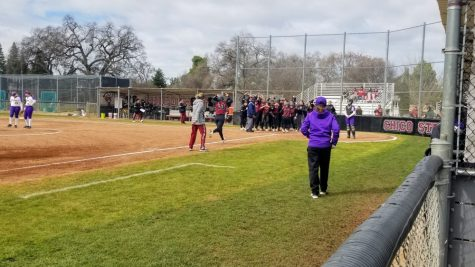 Bailey Akins celebrates her home run at home plate with her teammates. Photo credit: Brandon Downs