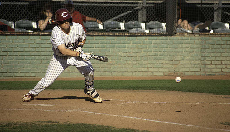 Tyler Stofiel hits a bunt and successfully gets to first, loading the bases during the second game on May 4, 2018, against Stanislaus State. Photo credit: Martin Chang