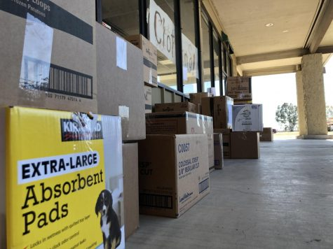 Boxes piled up outside the Orland Camp Fire Donation Center on the first of a three-day yard sale Photo credit: Trenton Taylor