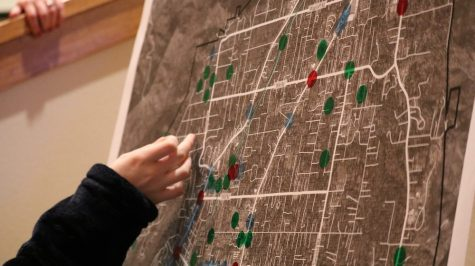 Paradise locals gather into groups and each member take turns placing dots on the Paradise map. The dots signify the strengths, weaknesses, and opportunities, Friday, Feb. 22, 2019, in Paradise, CA. Photo credit: Melissa Herrera