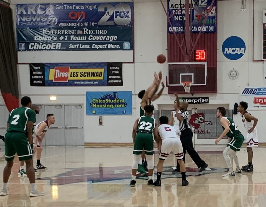 Chico State and Humboldt State jump ball to start their game on Saturday, Feb. 2 at Acker Gym. Photo credit: Ricardo Tovar