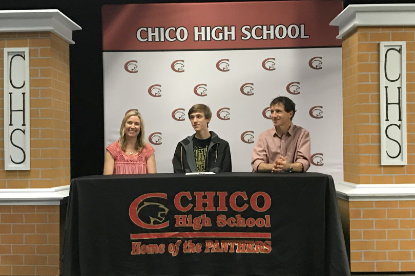 Chico High's Charlie Giannini (center) and parents Meghan Callahan (left) and Scott Giannini (right) smile during a ceremony Wednesday at Williams Theater in Chico where the senior signed his letter of intent with the Chico State men's cross-country team. (Will Denner -- Enterprise-Record)