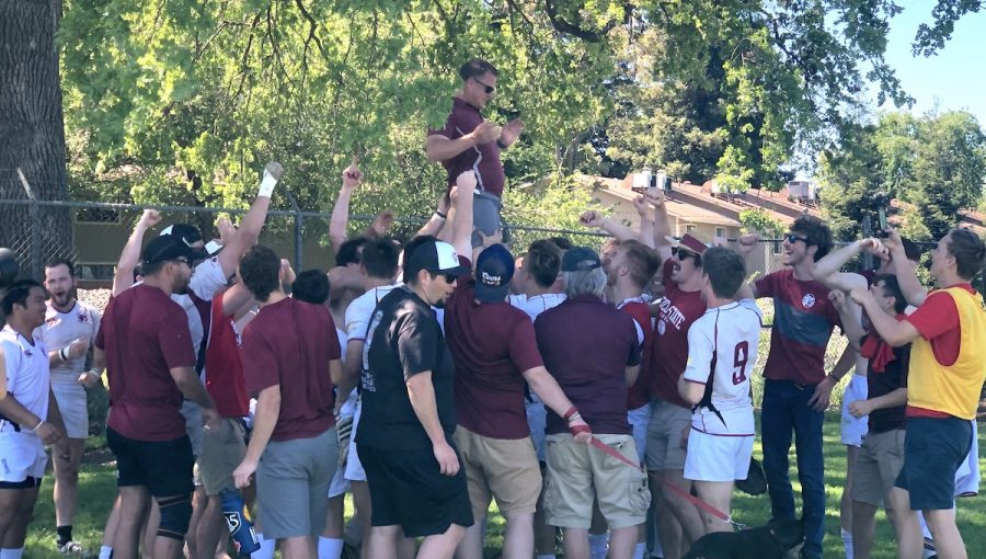 The Chico State rugby team hoist up head coach Lucas Bradbury after the win against Cal State Long Beach on Sunday. Photo credit: Ricardo Tovar