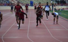 Joshua Cummings and Isaiah Roybal running a medley race at University Stadium, Photo Courtesy of Sports Information