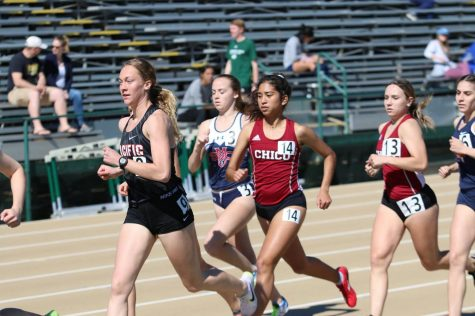 Distance runners Nadine Dubon and Taylor Bailey in the middle of competing. Image Courtesy of Gary Towne Photo credit: Gary Towne