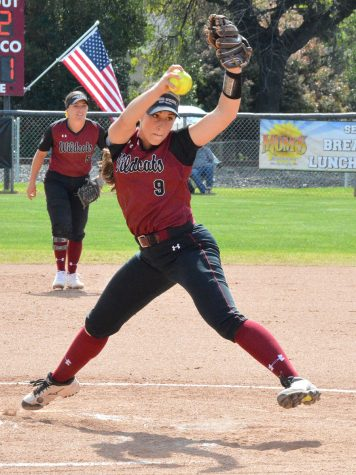 Naomi Monahan winds up to throw an underhand pitch against the Stanislaus State batter during Saturday's game. Photo credit: Olyvia Simpson
