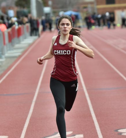 Lyndsey Settle running a sprint at University Stadium, Photo Courtesy of Sports Information