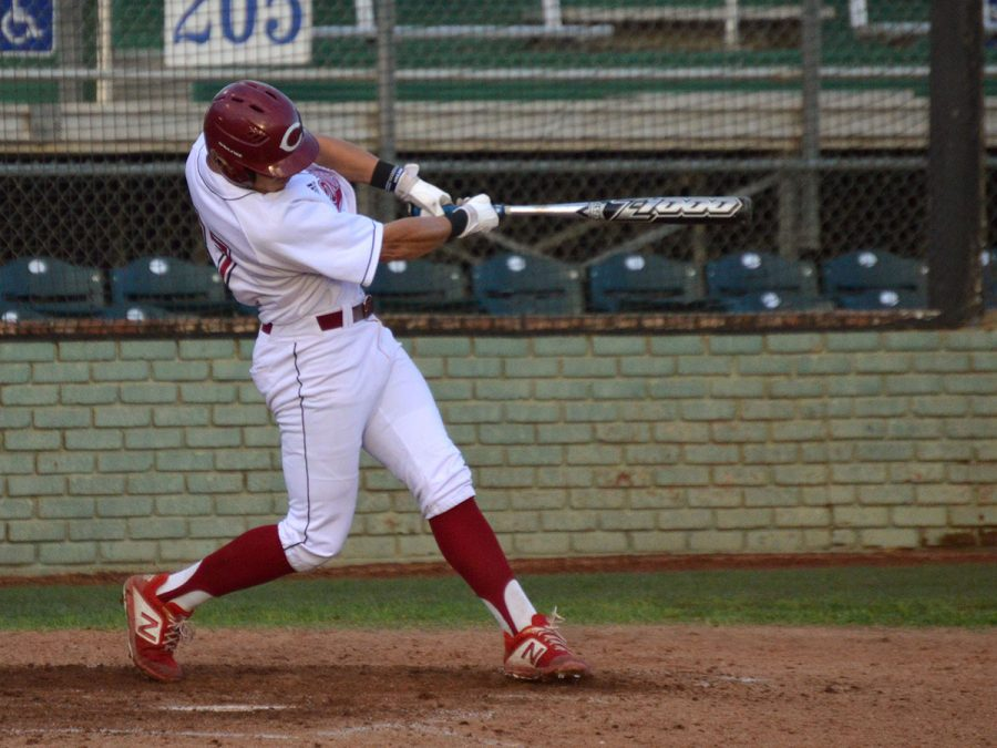 Eddie Zavala takes a swing in a game against Cal State San Marcos on April 5, 2019. Photo credit: Olyvia Simpson