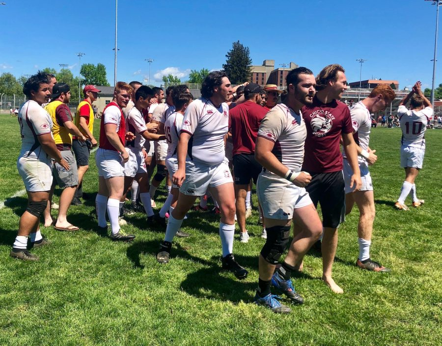 Chico State men's rugby team celebrating beating Cal State Long Beach on April 21. Photo credit: Ricardo Tovar