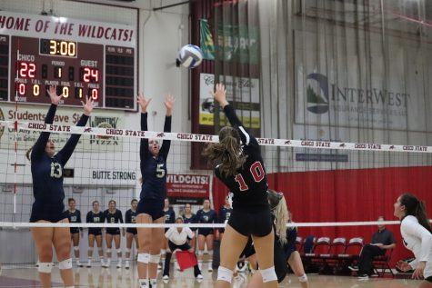 Bekah Boyle spikes the ball past Monterrey Bay's blockers. Photo credit: Mary Vogel