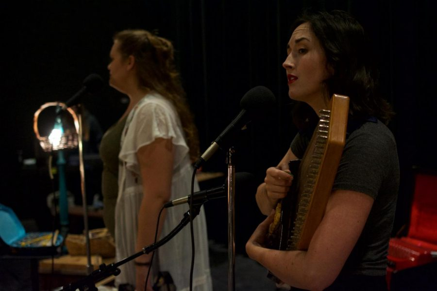 Band member Rebecca Rowland (left) performing in