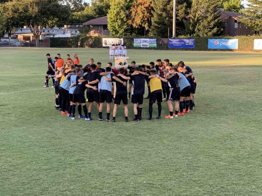 The Chico State men's soccer team huddled before their exhibition match against Holy Names University. Aug. 31, 2019 Photo credit: Lucero Del Rayo-Nava