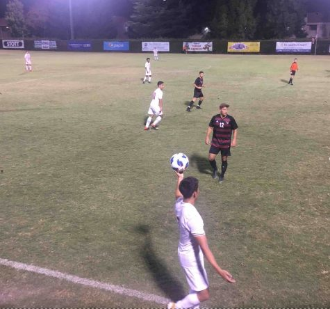 Anthony Kaskie getting in position during a throw-in against Holy Names University. Aug. 31, 2019. Photo credit: Karina Cope