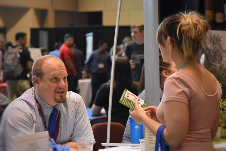 Students went to each booth and talked with recruiters about potential employments. Photo credit: Hana Beaty