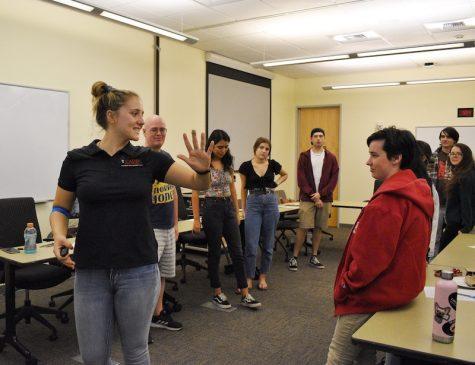 CADEC volunteer, third year Giianna Lagorio leads students through interactive activity,