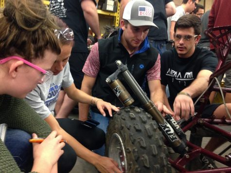 Baja Club students working on their car. Photo credit: Julian Mendoza