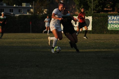 Alexi Vonsolos fights for ball against Cal Poly Pomona defender. Photo credit: Wesley Harris