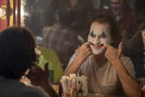 Arthur Fleck (Joaquin Phoenix) is a failed comedian who's a downward spiral into madness transforms him into the Joker.  Warner Bros. website photo